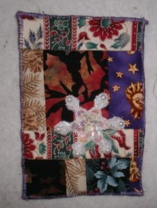 One of the many snowflake appliques in my collection