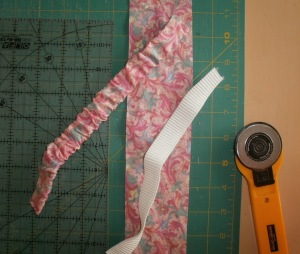 Sew a tube, scrunch it, insert elastic.