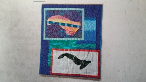 My Cuba quilt - blue ribbon on the side, gold on top and bottom